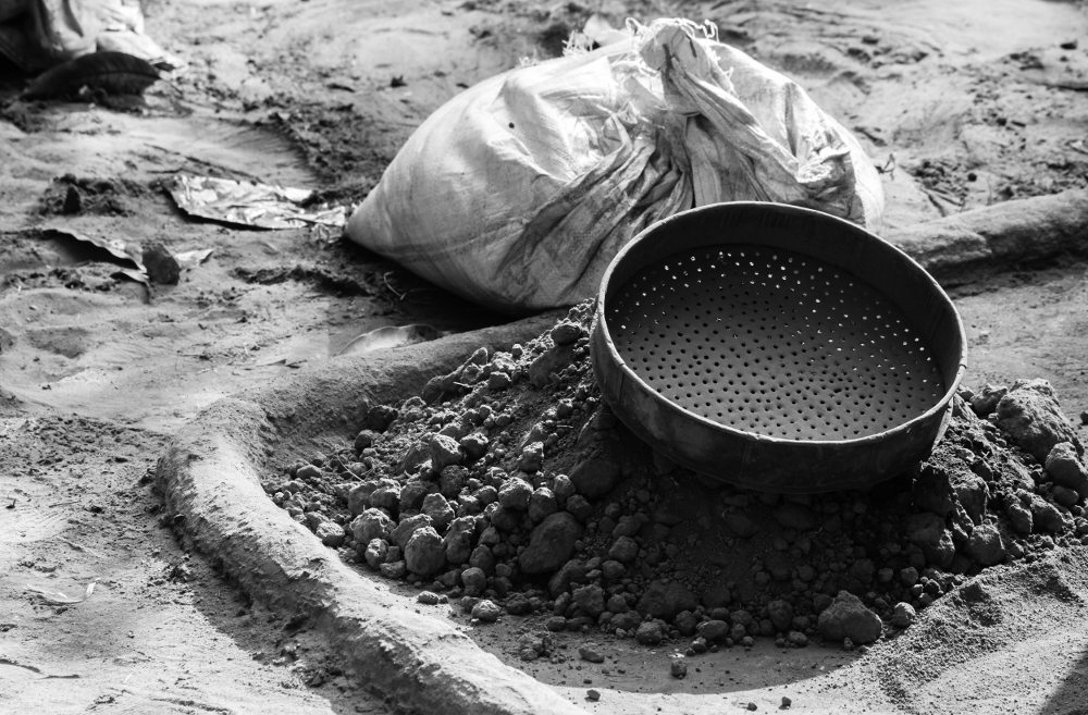 Screening of sand and clay in an Indian village